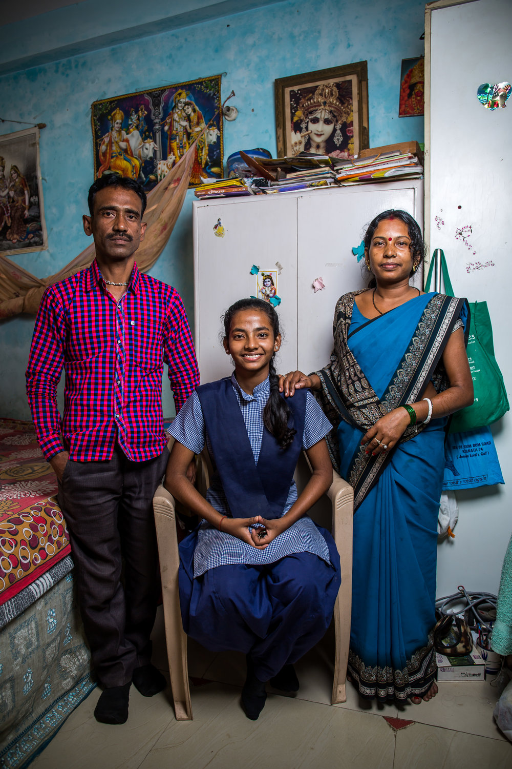 14 year old Rani and her parents inside their one room home