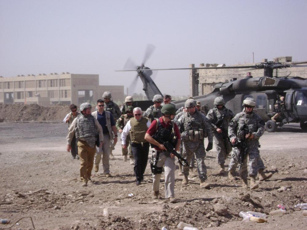 Sec Gates arriving at joint U.S.-Iraqi base.