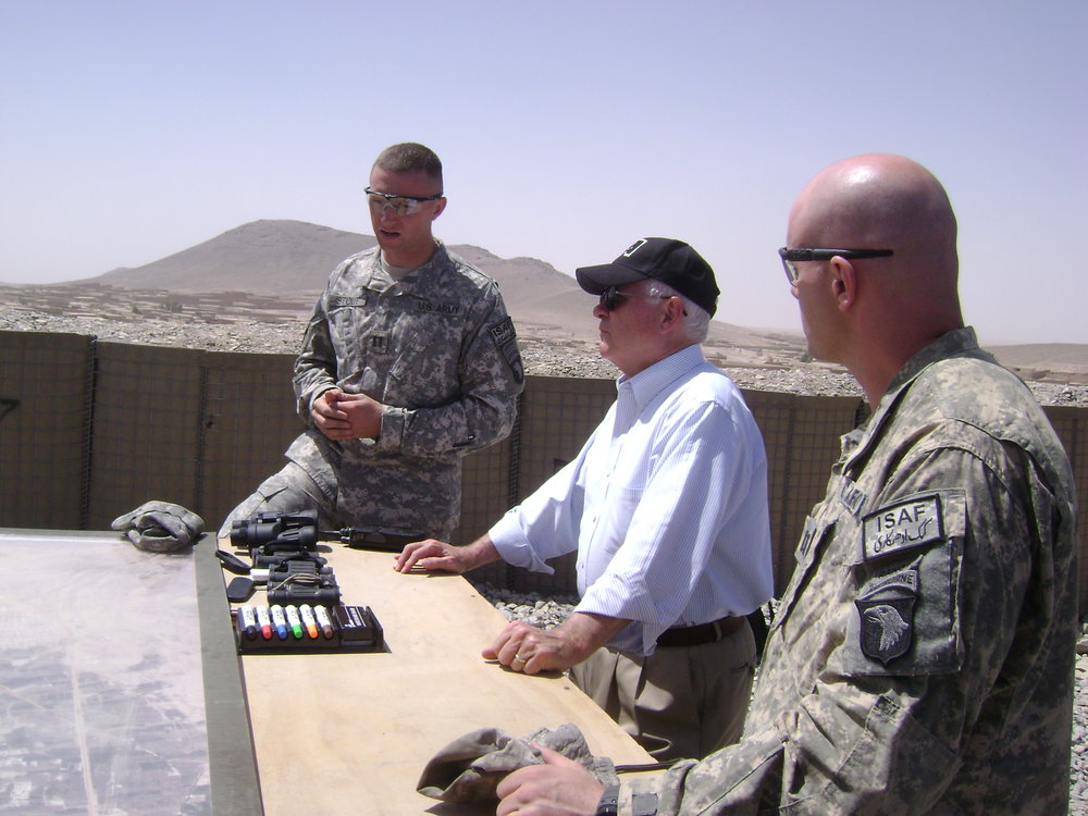 Sec Gates at observation point, on a hill inside a U.S. forward operating base, Afghanistan, 2009.