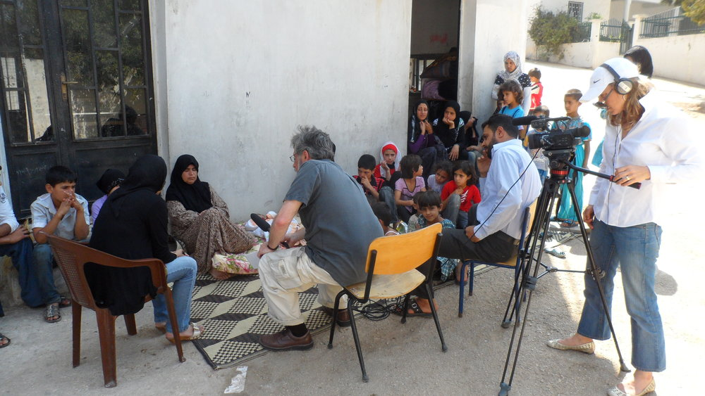 Interviewing Syrian refugees, with videographer Paige Kollack, northern Lebanon, 2012.