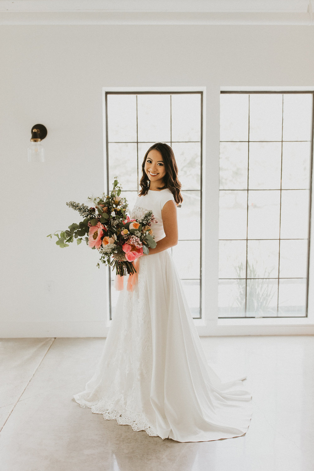 Look how that bouquet just pops against the dress? And the unique hem-line in the front of the dress where the lace cascades down the length of the front! DREAMY!