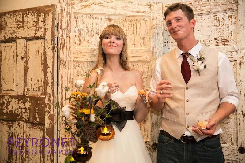Cake cutting fall texas rustic wedding grooms cake Double Creek Crossing Peyronet Photography