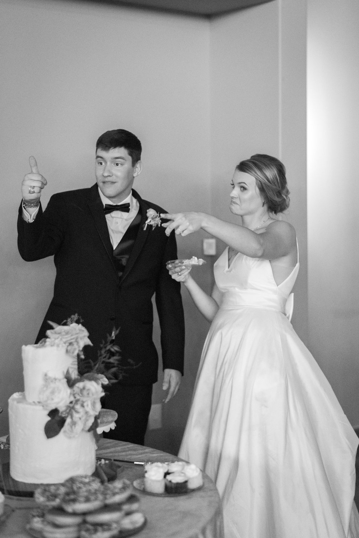 bride and groom cake cutting erin elizabeth photography wedding coordinator epoch co