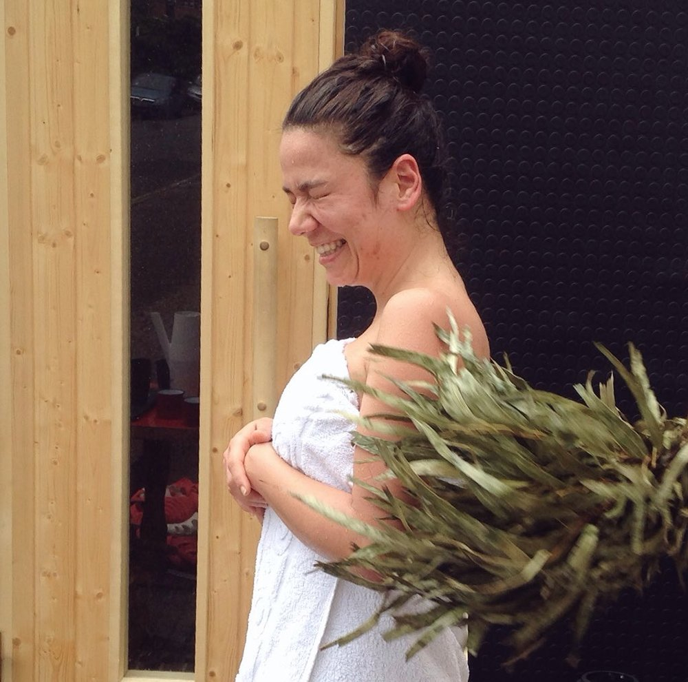 A sauna guest experiencing the vihta, a Finnish tradition