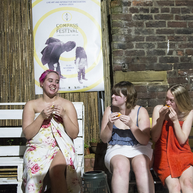 Sauna audiences enjoying a slice of orange after being taken around Nick's storytelling tour of the New Docklands Steam Baths in Canning Town. Compass Festival 2016.