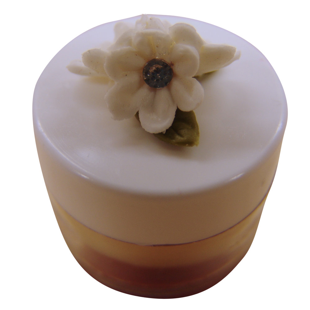 This shows a layered natural lip balm made by a Soap School student for a wedding favour