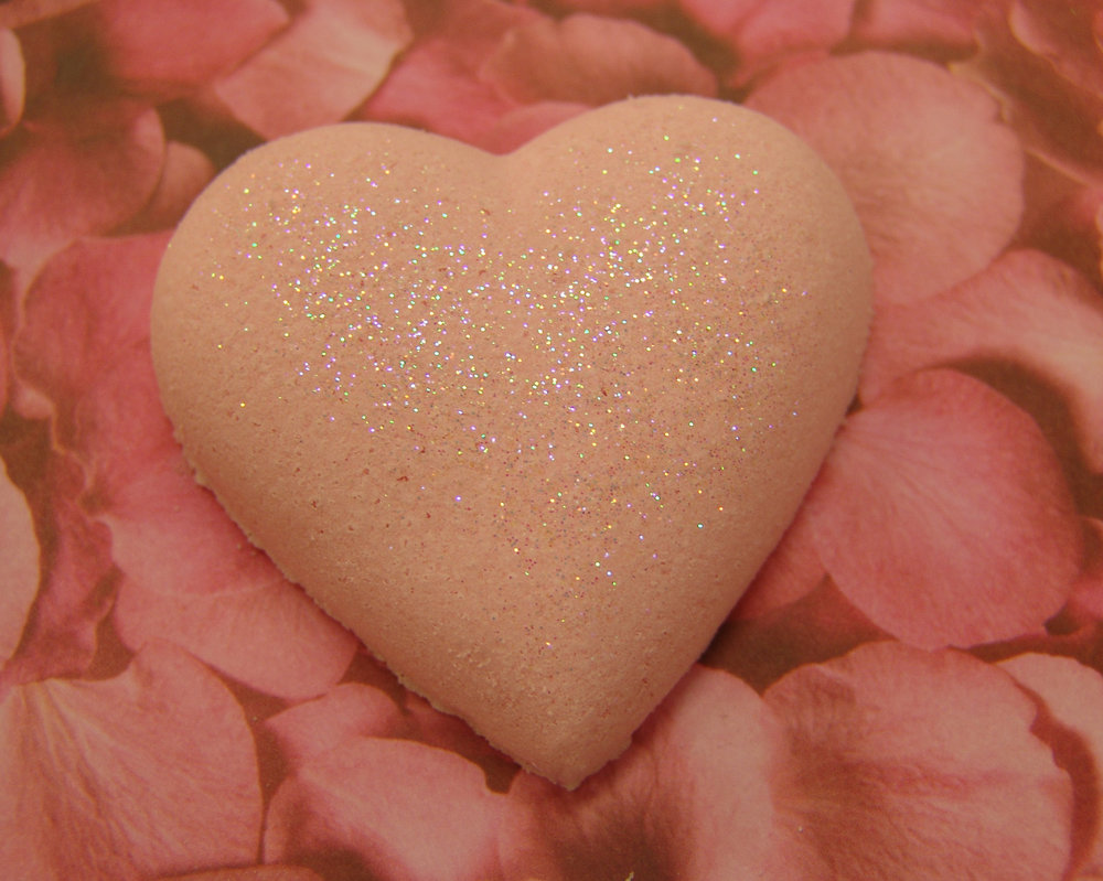 Rose glitter bath bomb in a pretty heart shape