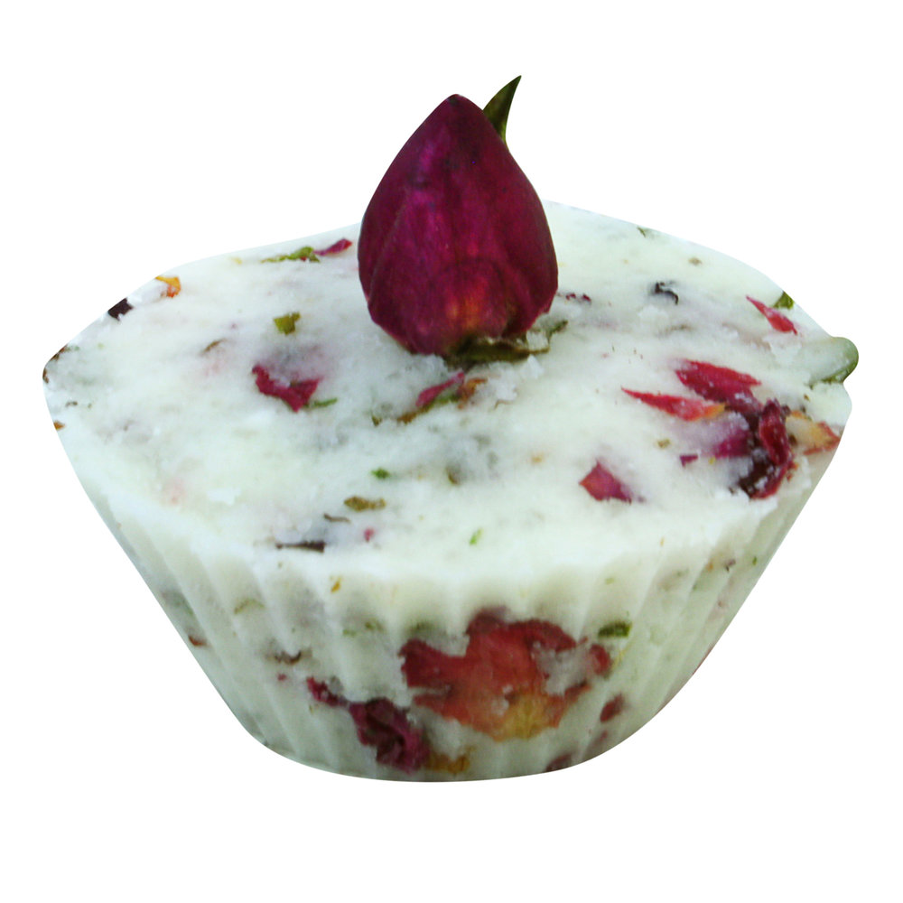Moisturising rose petal bath creamer topped with a red rose bud