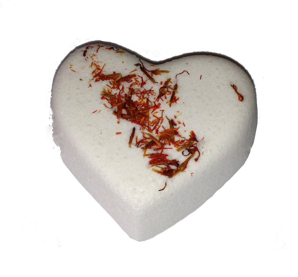 a flat backed bath bomb with safflower petals