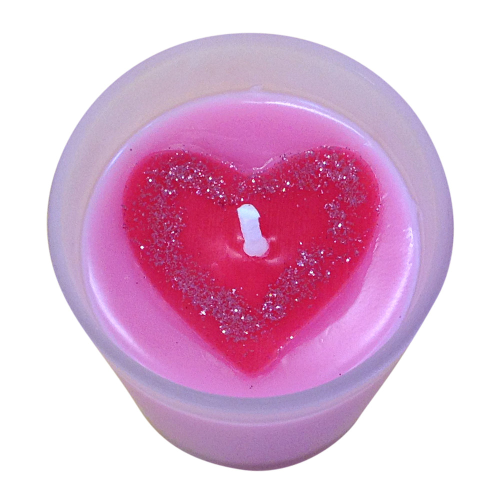 Pretty pink heart topped candle