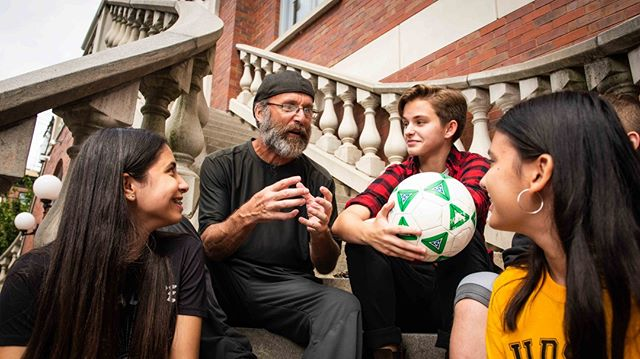 More #portraits from the staircase. #Teacher talking to #students about #football or #soccer if you're from the #USA