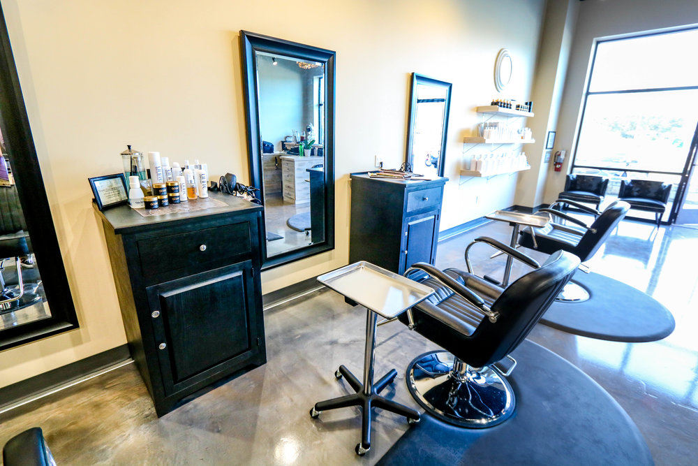 Photo of a stylist station at Spoleti Salon that includes their station products.