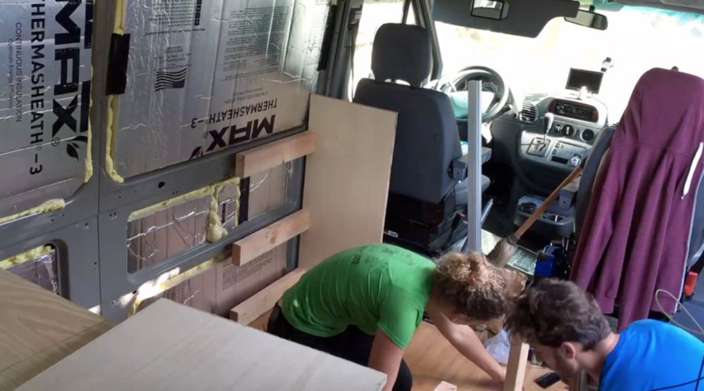 2x4's separate the cabinets and is screwed to the van wall