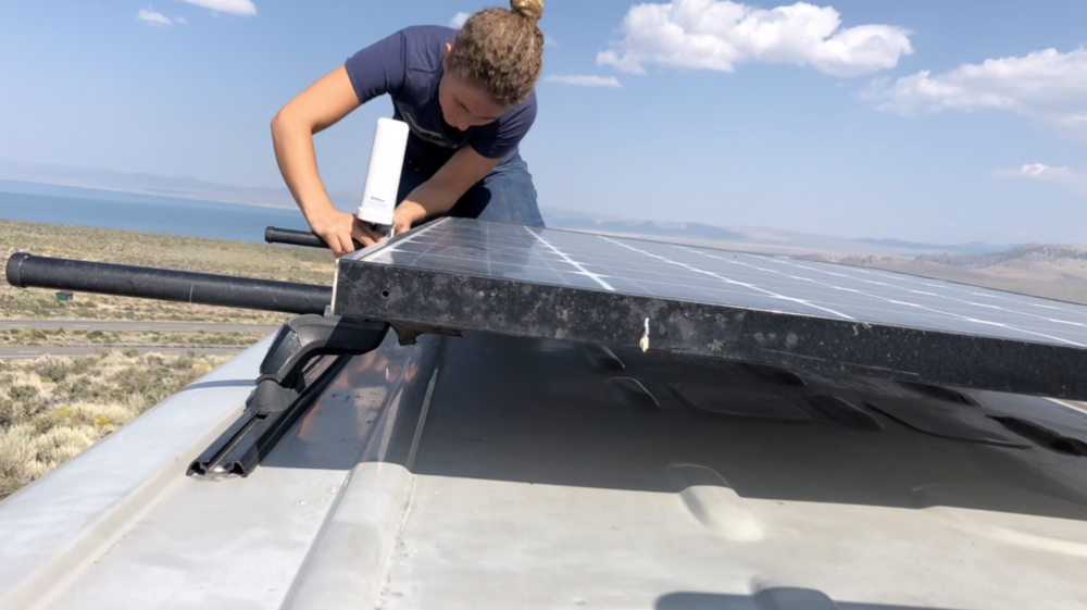Kaya Lindsay mounting the Weboost 4g x on her roof