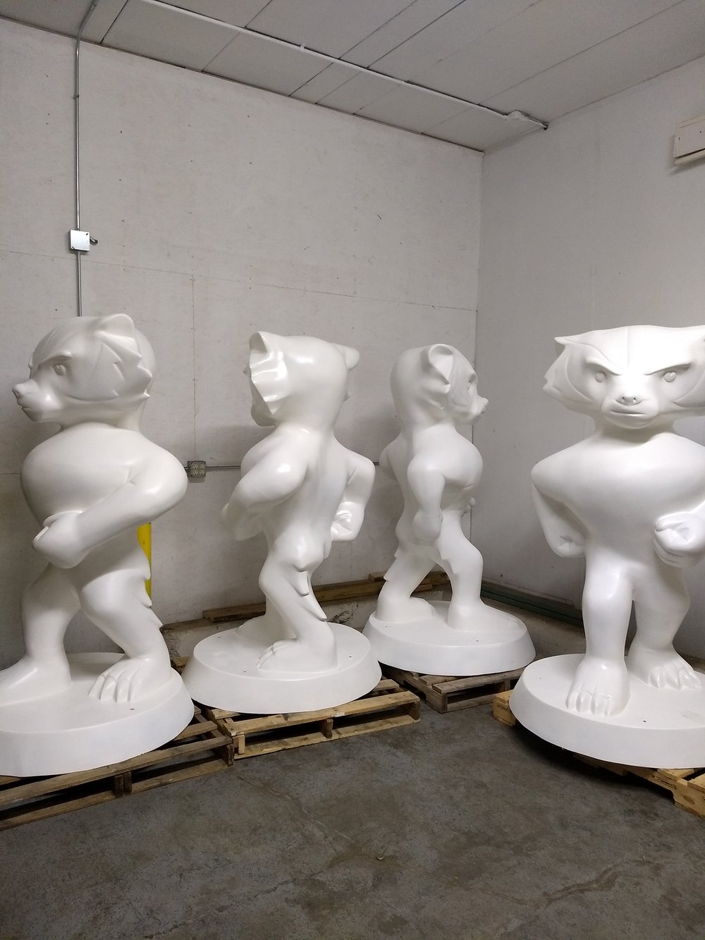 The blank fiberglass sculptures, waiting to be painted