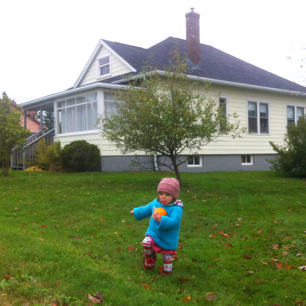 Little Lucy playing in the yard of our city house.