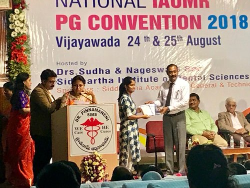 Post graduate student Dr.J.Abarna getting the 'Best Paper Award' for the paper on 'Applications of 3D printing in dentistry' in National PG Convention 2018 held at Vijayawada