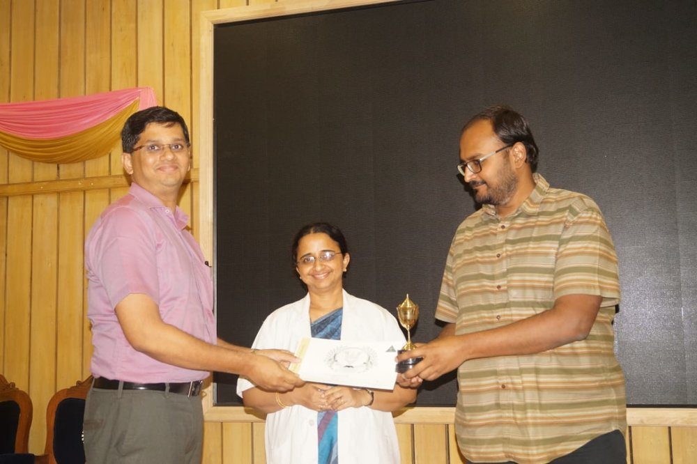 Dr.Jayanth getting the punctuality award from the Dean and Director of Academics
