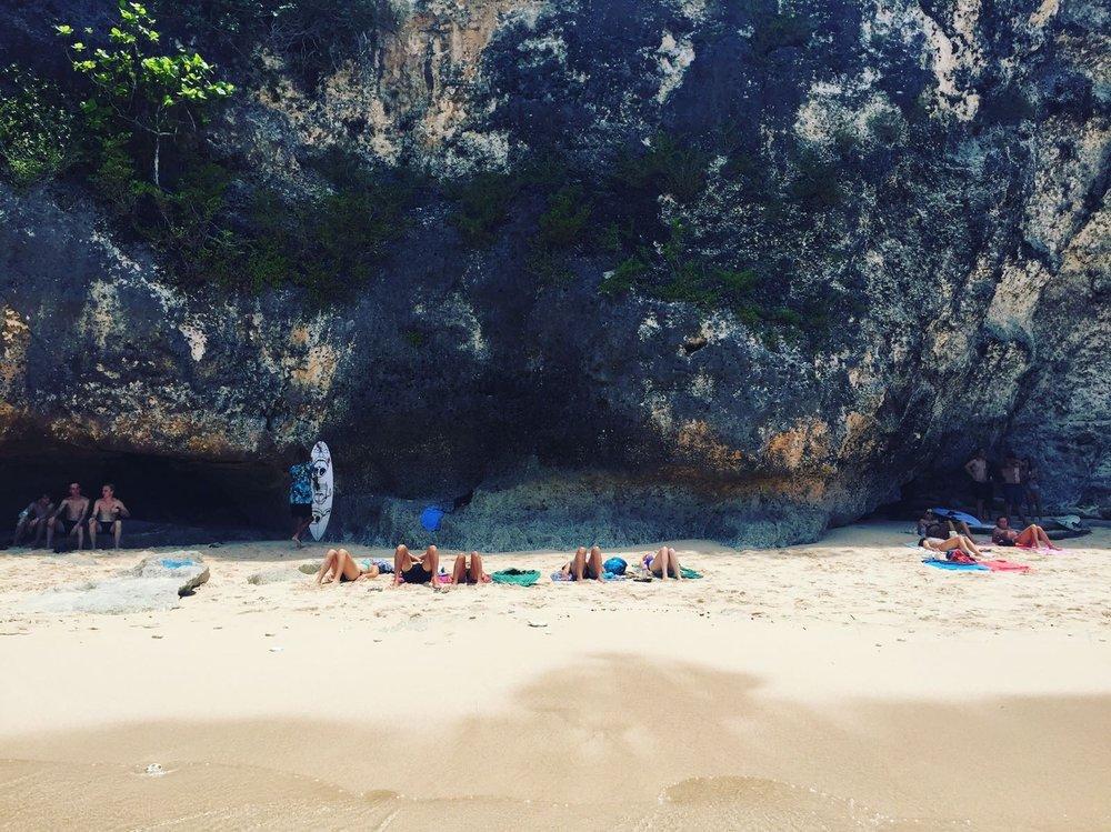 Laying out on the hidden beach in Uluwatu, Bali.