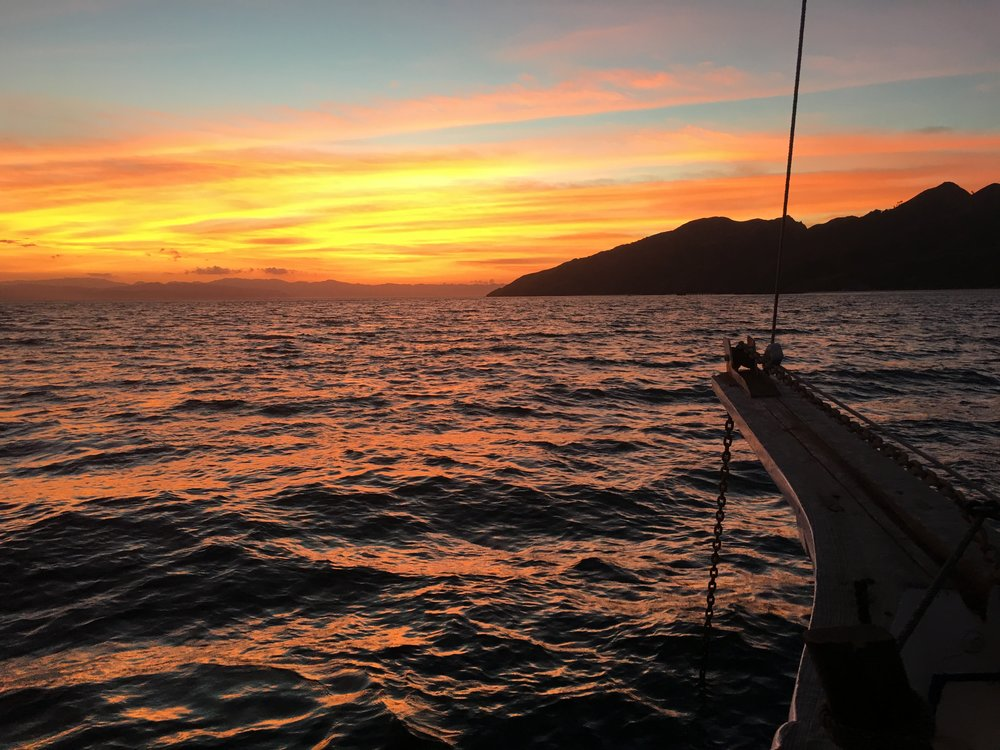 Sunrise over Halura Island from the deck of the Sri Noa Noa.