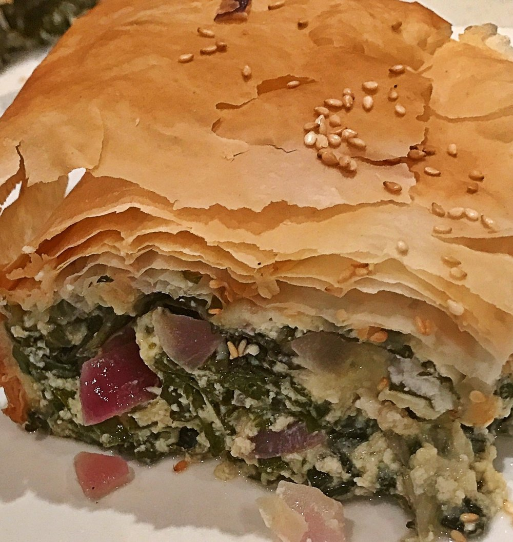 Spinach and Feta Pie - (a healthier twist on the traditional spanakopita) Serves 6-8Ingredients2 x bunches silverbeet, stalks removed and roughly chopped1 x large onion, finely diced1 x zucchini, grated and liquid squeezed out1 x bunch of mint, finely chopped2 x cloves garlic, crushed6 x eggs, lightly beaten200g reduced fat feta cheese, crumbled6 x sheets reduced-fat filo pastry½ cup Greek style natural yoghurtOlive oil spraySesame seeds MethodCombine silverbeet, onion, zucchini, mint, garlic, eggs and feta in a large bowl (I use a big plastic container and my hands to mix).Pack silverbeet mix into a large rectangular baking dish.Place two sheets of filo pastry on top and tuck edges in. You need to compress the silverbeet mixture quite firmly and tuck the edges down the side of the dish.Spread half of the yoghurt over the pastry with a pastry brush, top with two more sheets of pastry and repeat with the other half of the yoghurt.Top with the final two sheets of pastry, give a light spray with olive oil and sprinkle with sesame seeds. I make a couple of incisions in the pastry before baking in a 180 degree oven for about 45 minutes.Cut into pieces and serve with a green salad.