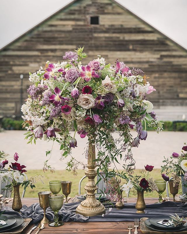 Where glam meets rustic: extravagant centerpiece by @pineapplepetalsstudio 🙌🏼👏🏻👏🏻👏🏻 vendor team below!! 👇🏼 . . . . . . . Styling + Coordinating: @eventsbyrebecca  Venue: @deercreek_wed Photography: @garyashleyphoto of @thewedding_ac Specialty Rentals: @botanicaspecialtyrentals  Florals: @pineapplepetalsstudio  Cake: @paperheartpatisserie Linens: @latavolalinen  Calligraphy + Paper Goods: @landlcreative  MUA: @mmartistry  Groom's Tux: @theblacktux Bridal Salon: @miosabride  Wedding Gown Designer: @enzoani