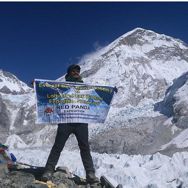One of our owners, Lenduk, as he displays our Expedition Banner for the trip.
