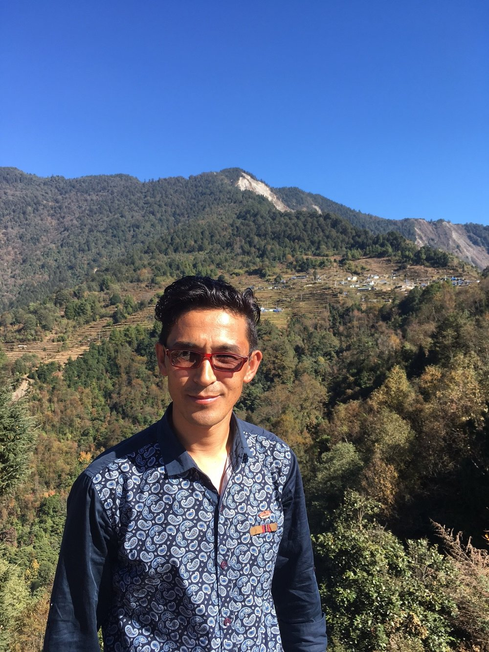 One of our Guides, Chhering, in front of his home village- Upper Gyangul.