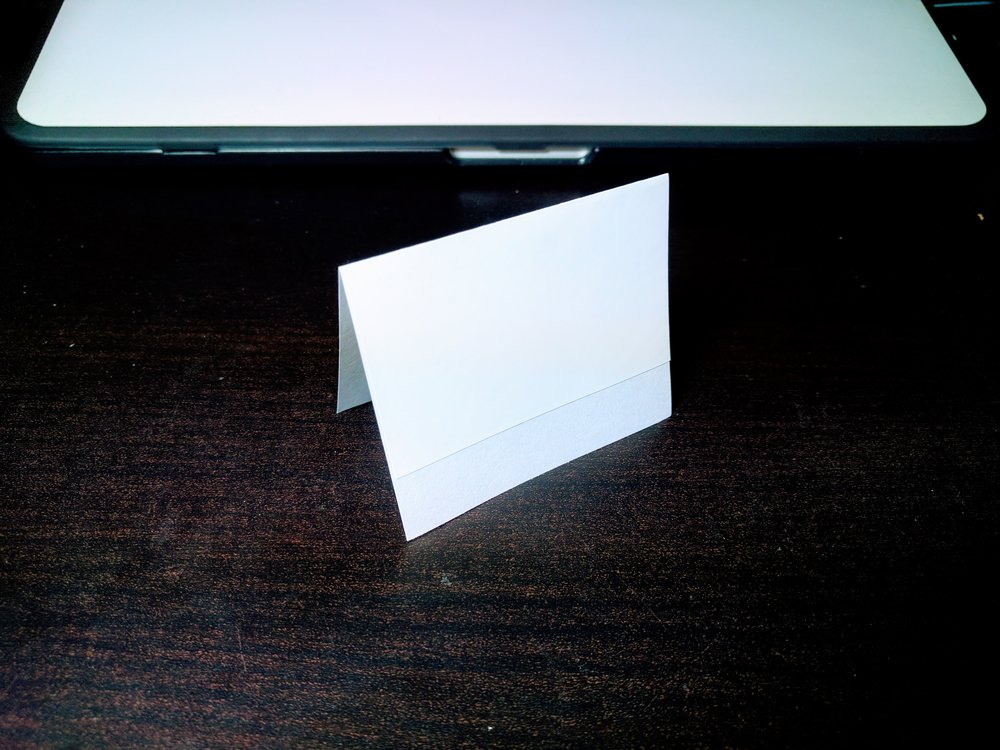 Apply the whiteboard sticker aligned at the top of the index card when it's standing.
