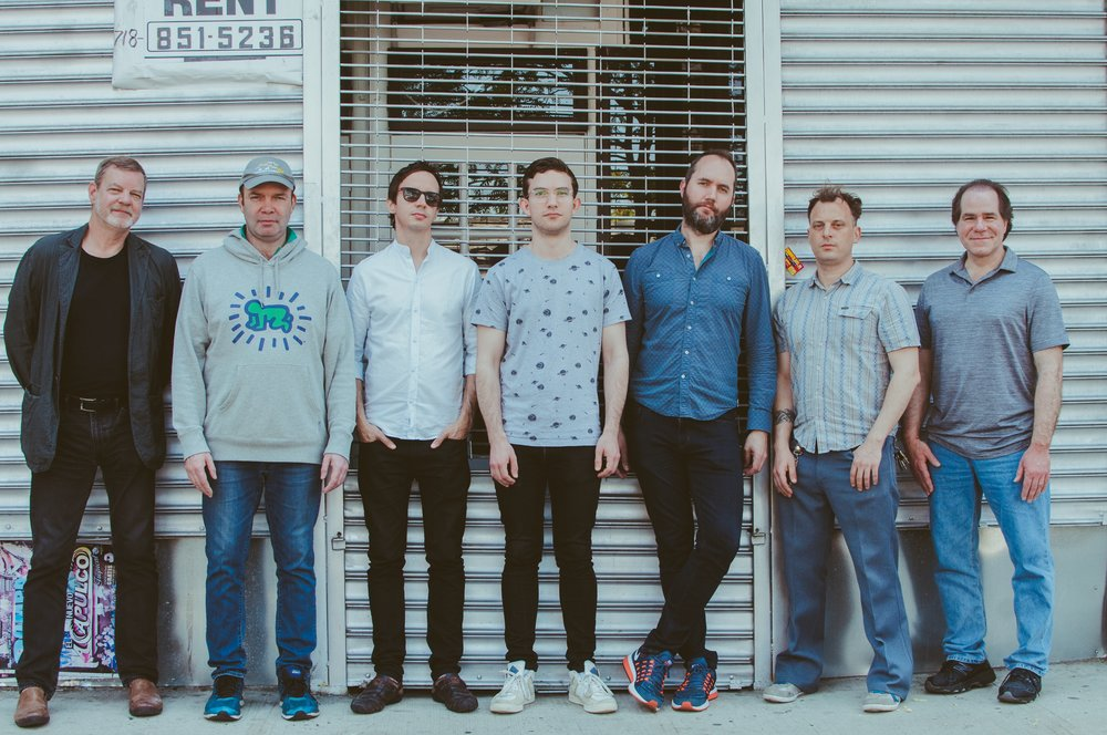 Left to right: Frank Kimbrough, Sean Wayland, Des White, Evan Harris, Will Vinson, Jochen Rueckert, Mike Marciano opposite Systems Two Studios, Ditmas Ave.