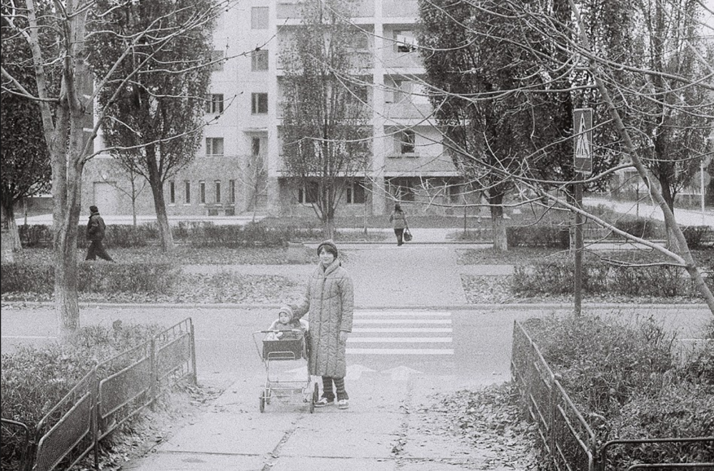Me and my mom in front of our former apartment house in Lenin Avenue 17, Prypyat