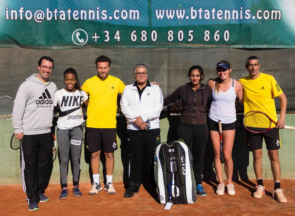 In the picture, our director Raphael with Ushna and her father in the middle, our coaches Jordane and Sixto and our full-time players Tebatso and Paige.