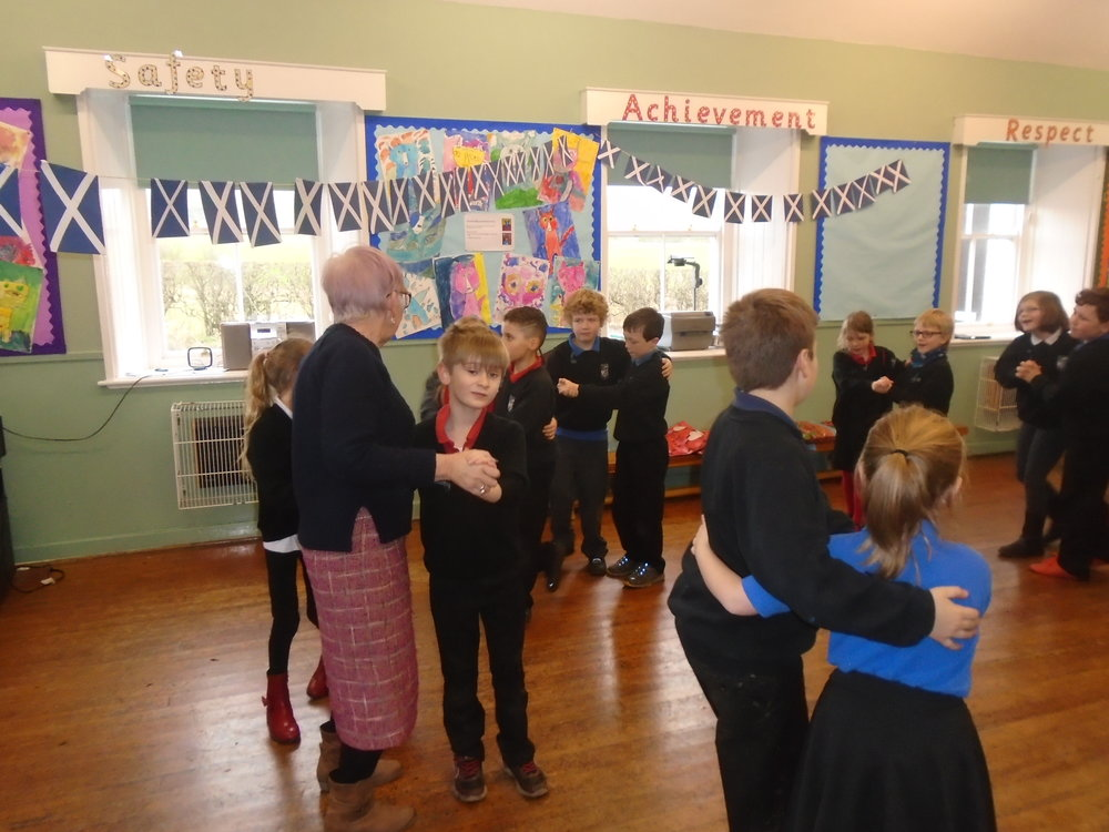 "Mrs Maxwell enjoying a dance with F at ""Wee Granny's Ceilidh""."