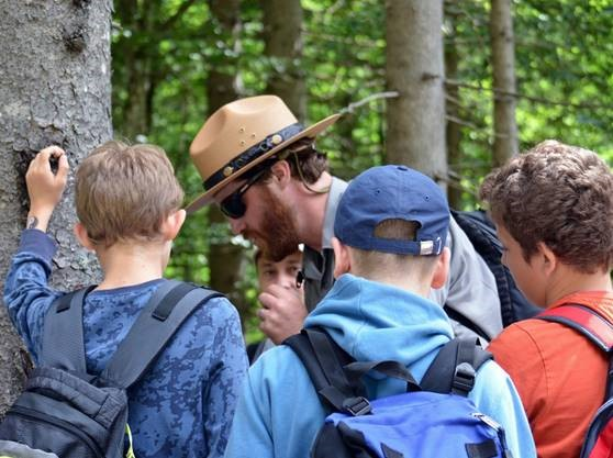 Ranger John Duwe teaches students to measure tree age at Triglav National Park, Slovenia.