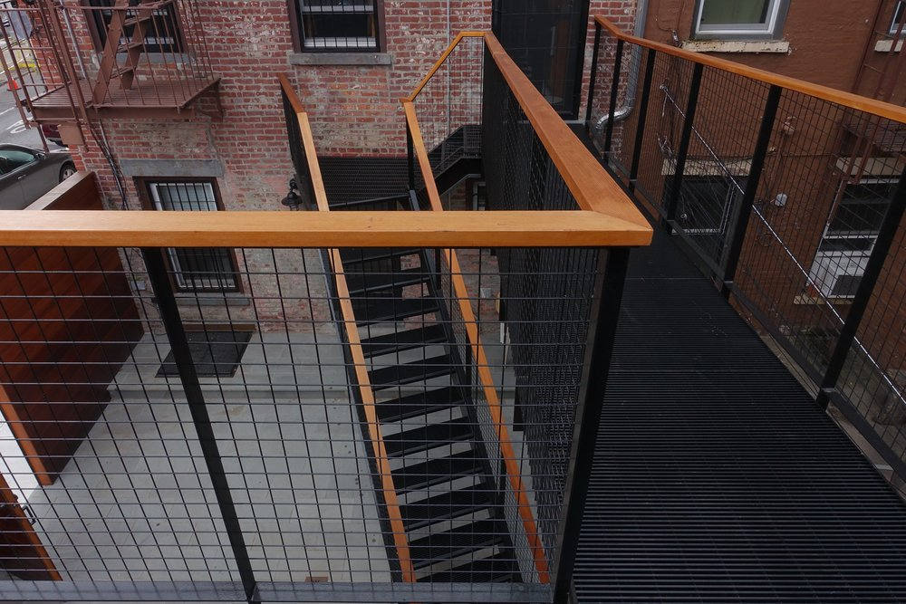The Bridge  This Carroll Gardens rear yard project involved a difficult engineering feat of connecting the parlor floor kitchen of this corner brownstone with a new roof deck on an existing garage, along with a stair to the yard below.