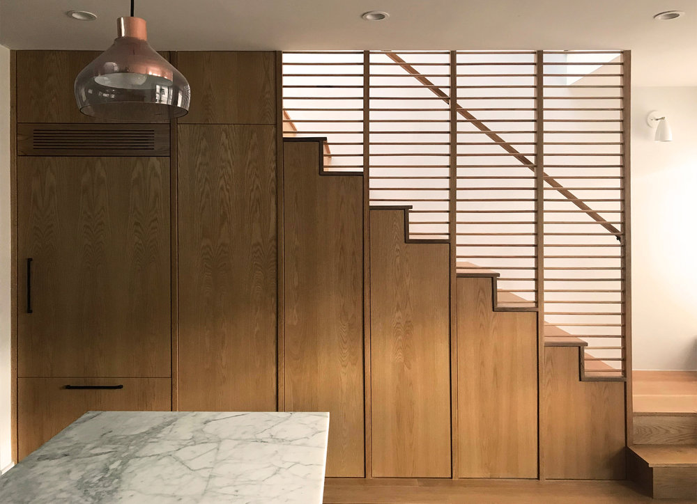 LoLed  This penthouse apartment in central Park Slope, Brooklyn, features several different approaches to day-lighting, and a stair connecting floors, using off-the-shelf components, with storage and refrigerator below, and maximum lighting from above.