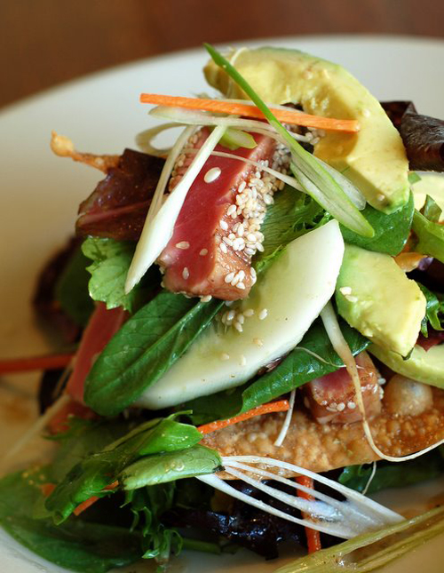 - Sesame Seared Tuna Salad with Field Greens, a Wonton Cracker, Cucumber, Avocado, Bean Sprouts, Scallions, and Shiitake Vinaigrette