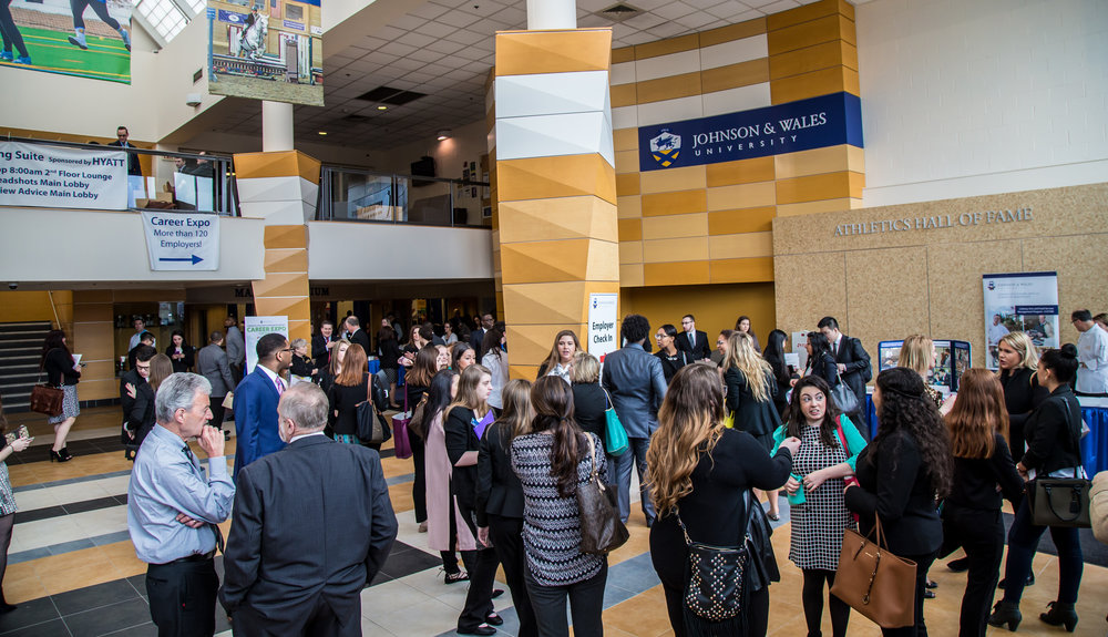 JWU students network at a career fair