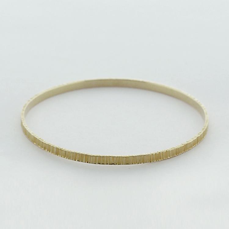 <b>Gold Bangle</b><br>$2,249<br>18K Yellow Gold