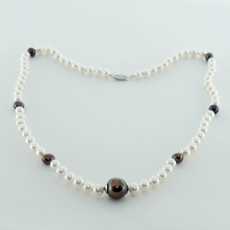 <b>Accent Pearls</b><br>$395<br>White and Black<br>Fresh Water Pearls