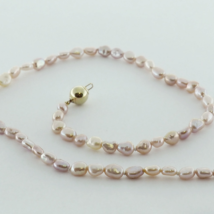 "<b>Natural Pink</b><br>$545<br> Natural Pink ""Biwa"" <br>Fresh Water Pearls"