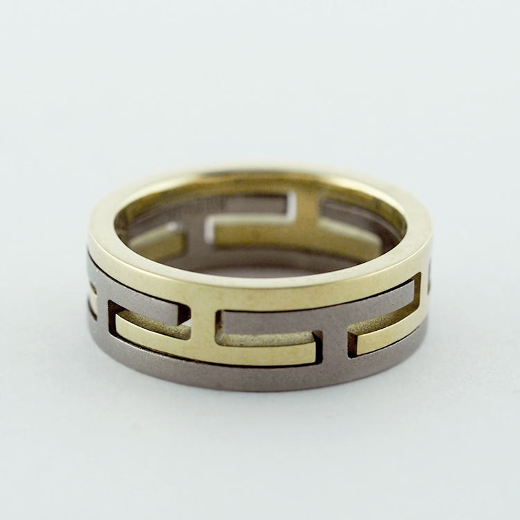 "$1,600<br>Titanium and 18K Yellow Gold<br>Two independent parts, interlocked!<br>""Model T"""