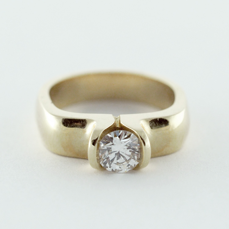 "$4,198<br>14K Yellow Gold, <br>Brilliant cut Diamond 0.50ct, F-vs1<br> Limited Edition 18/99<br>Design: ""Tulip Classic 3D"""