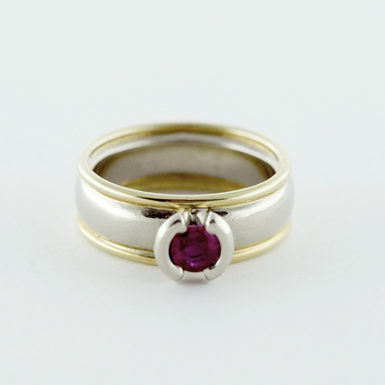 "$3,885<Br>19K White & 18K Yellow Gold,<br>Limited Edition: 3/99<br>round Ruby 0.473ct<br>Design: ""Fanfare"""