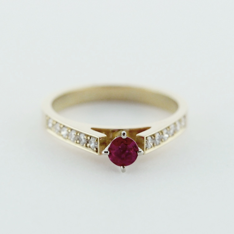 "$1,695<br>14K Yellow Gold & 19K White Gold,<br> 12 Brilliant cut Diamonds<br> Round Ruby of 0.29ct<br> Design: ""Petite"""