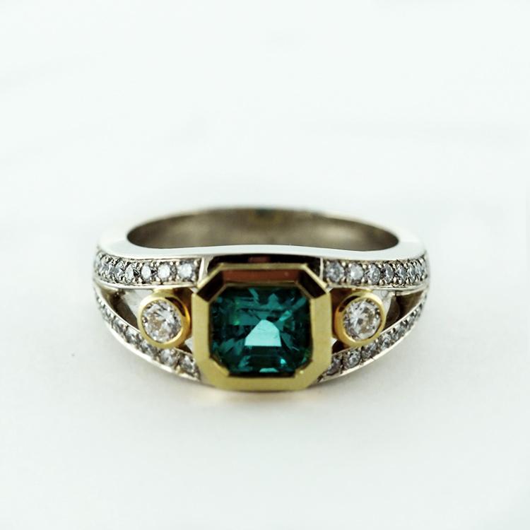$11,850<Br>19K White Gold,<br> 18K Yellow Gold,<Br>Emerald, 42 Brilliant <br>Cut Diamonds