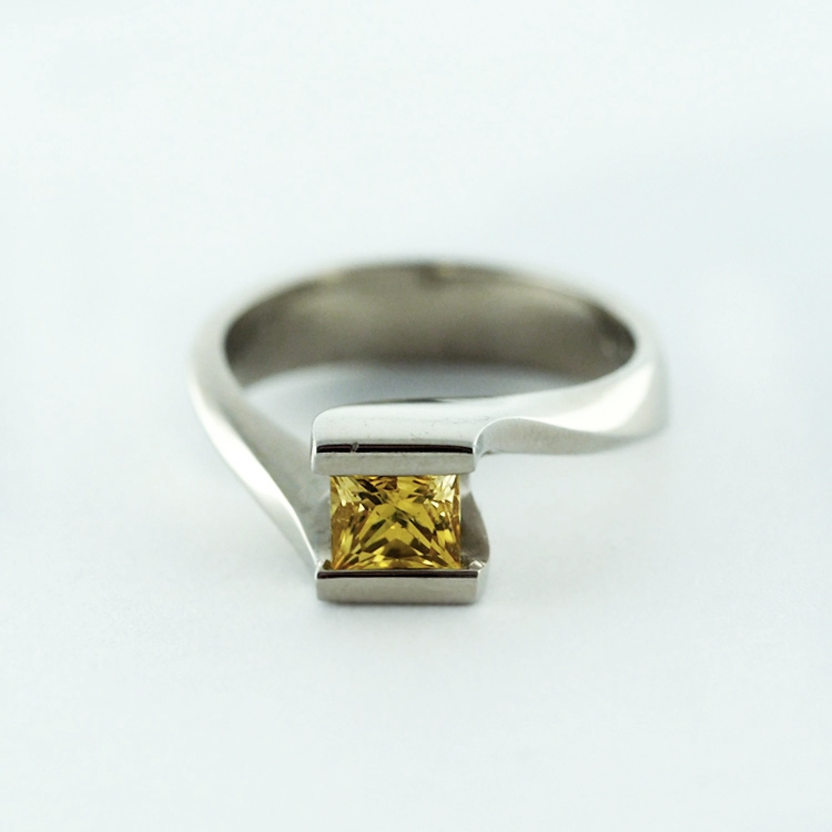 reg.RT:$2,674/ LT-Promotion: $2,005<br>19K White Gold, <br>Limited Edition 3/99,<br> Princess Cut<br> Yellow Sapphire 0.55ct