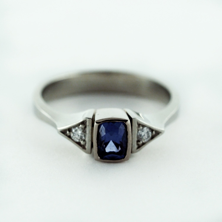 $2,869<br>19K White Gold,<br> Blue Spinel of 0.55 ct,<br> 2 Brilliant Cut<br> Diamonds