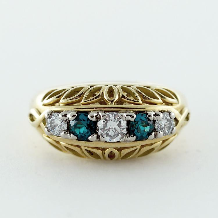 $4,536<br>18K Yellow Gold, <br>2 Green Emeralds, <br>3 Brilliant Cut <br>Diamonds