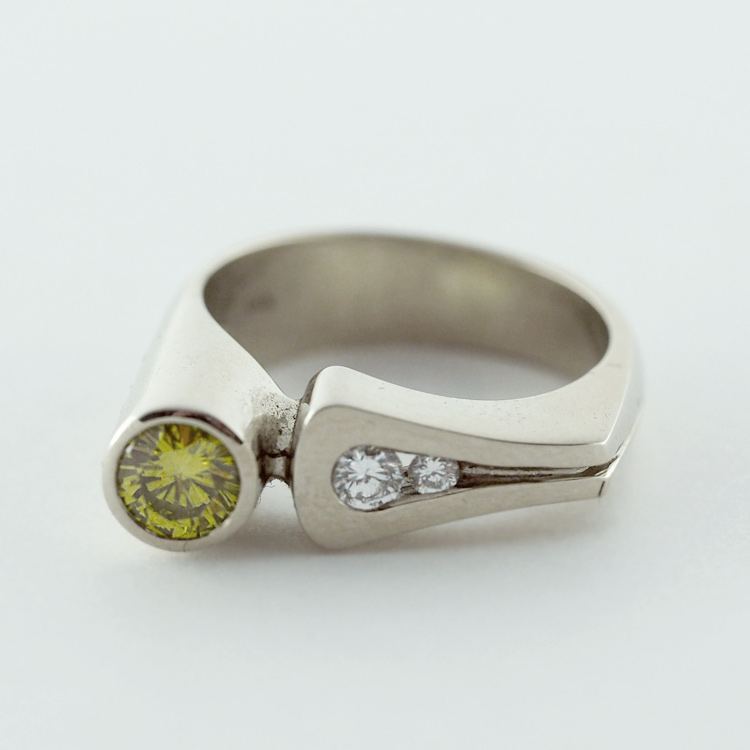 "$4,970<br>19K White Gold, <br>Limited Edition 5/99<br> ""Offset Delight"",<br>Yellow Diamond,<br> 2 Brilliant Cut <br>Diamonds"